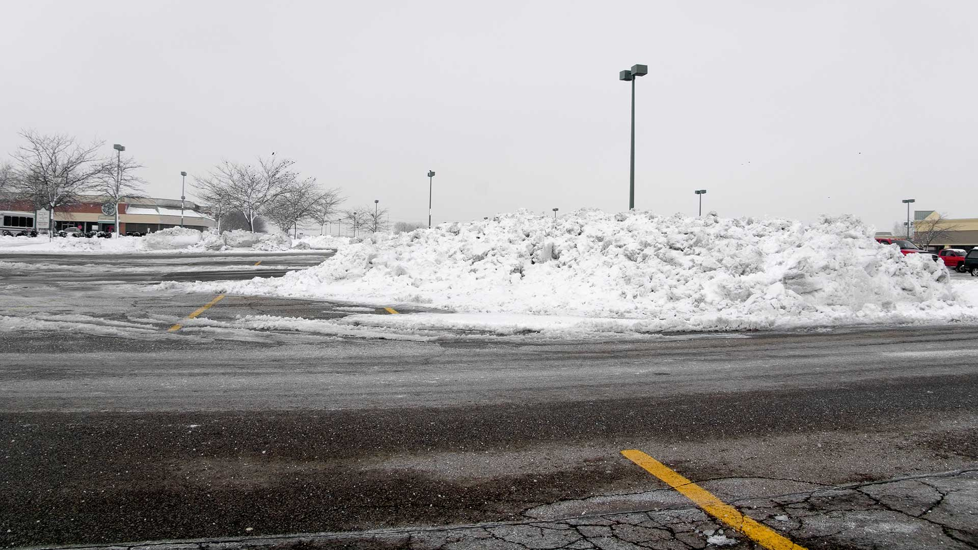 A parking lot in Waterloo, IL where we cleared and piled up snow.