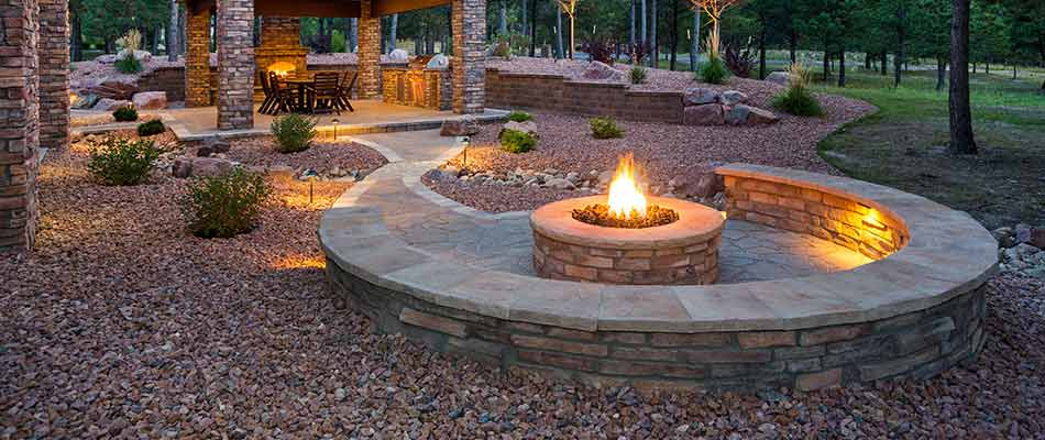 A fire pit in Millstadt, IL surrounded by landscape design and retaining walls.