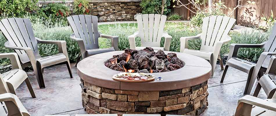 This custom patio and fire pit in Columbia, IL provides a great outdoor space for the homeowner.