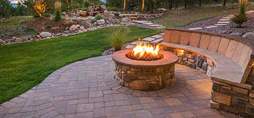 A custom fire pit and patio installed at a home in Red Bud, IL.