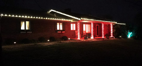 A home decorated with holiday lights in Millstadt, IL.