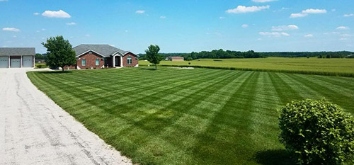 A home in Columbia, IL that receives regular lawn maintenance services.