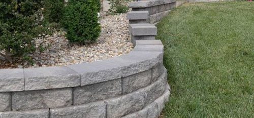 A custom retaining wall and steps installed at a home in Red Bud, IL.